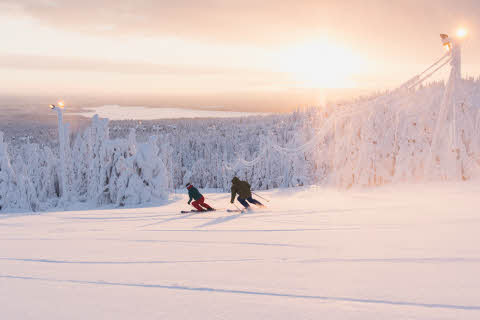 Ruka Ski Resort, skiers in sunset
