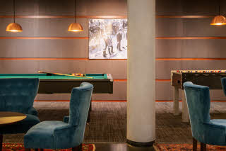 pool table in lobby at scandic foresta in stockholm sweden