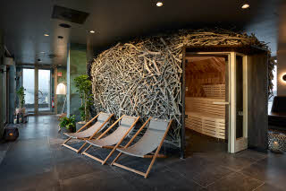 The Nest, spa with sauna and chairs
