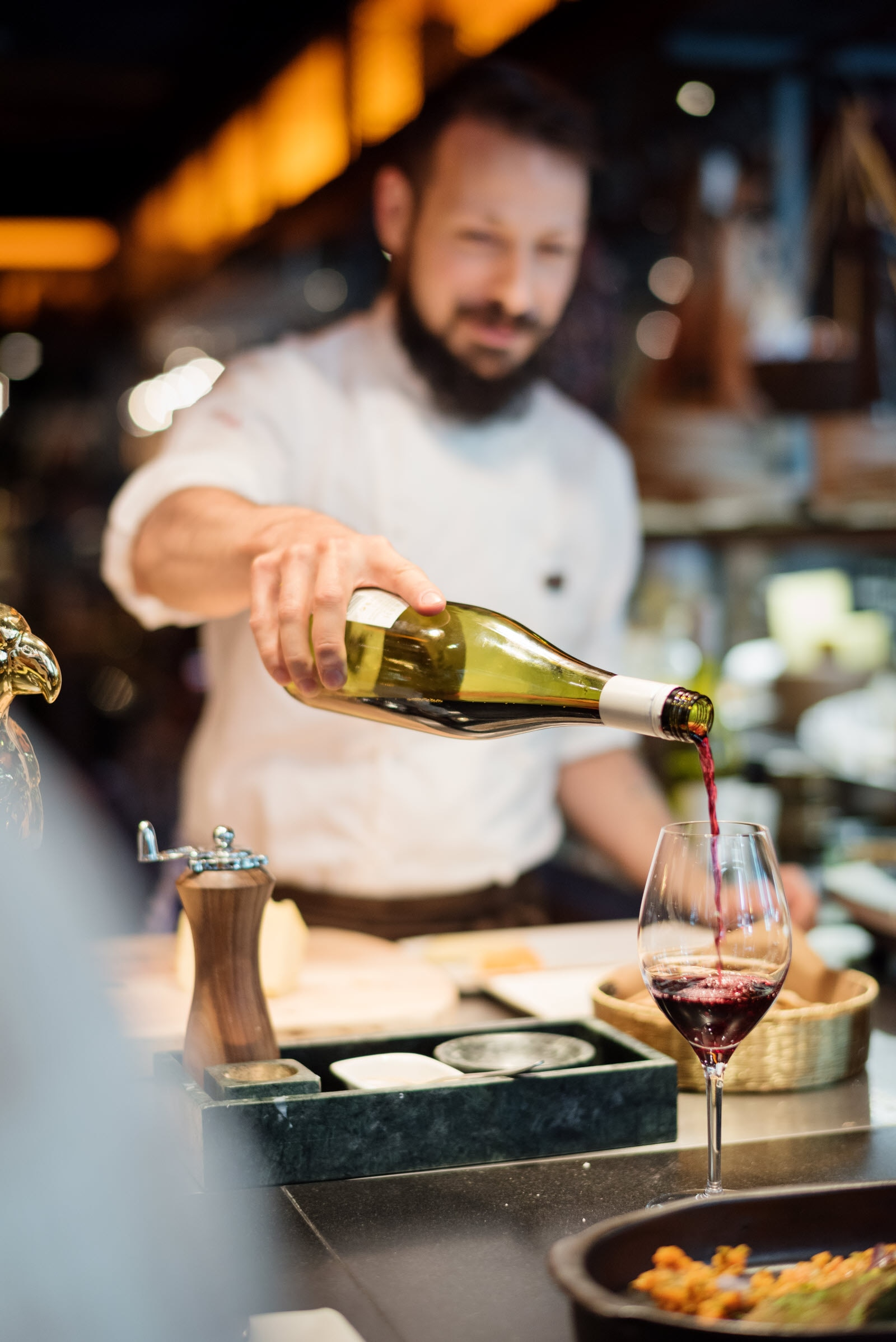 Restaurant staff serving wine