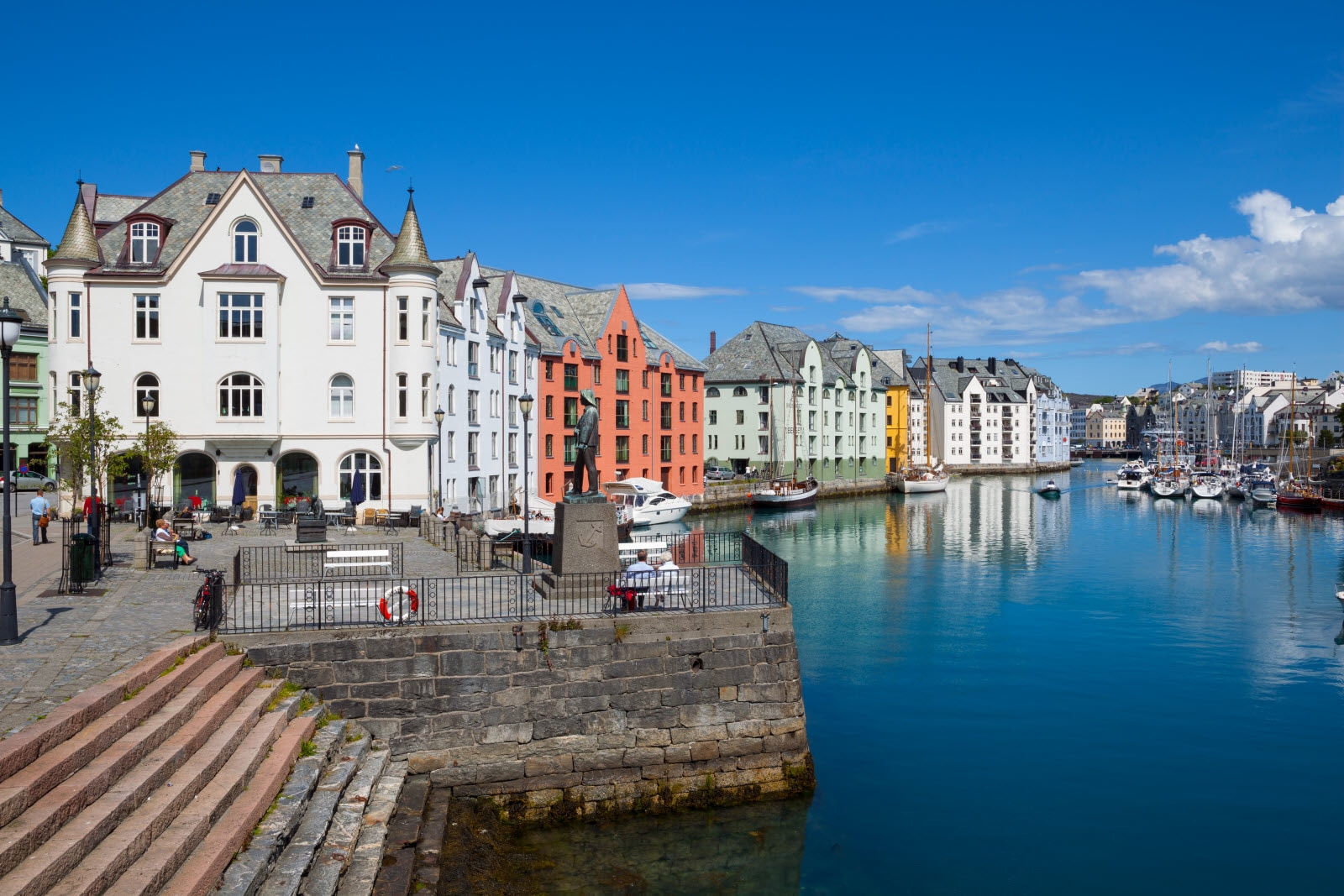 Old fishing warehouses in harbor, Alesund,