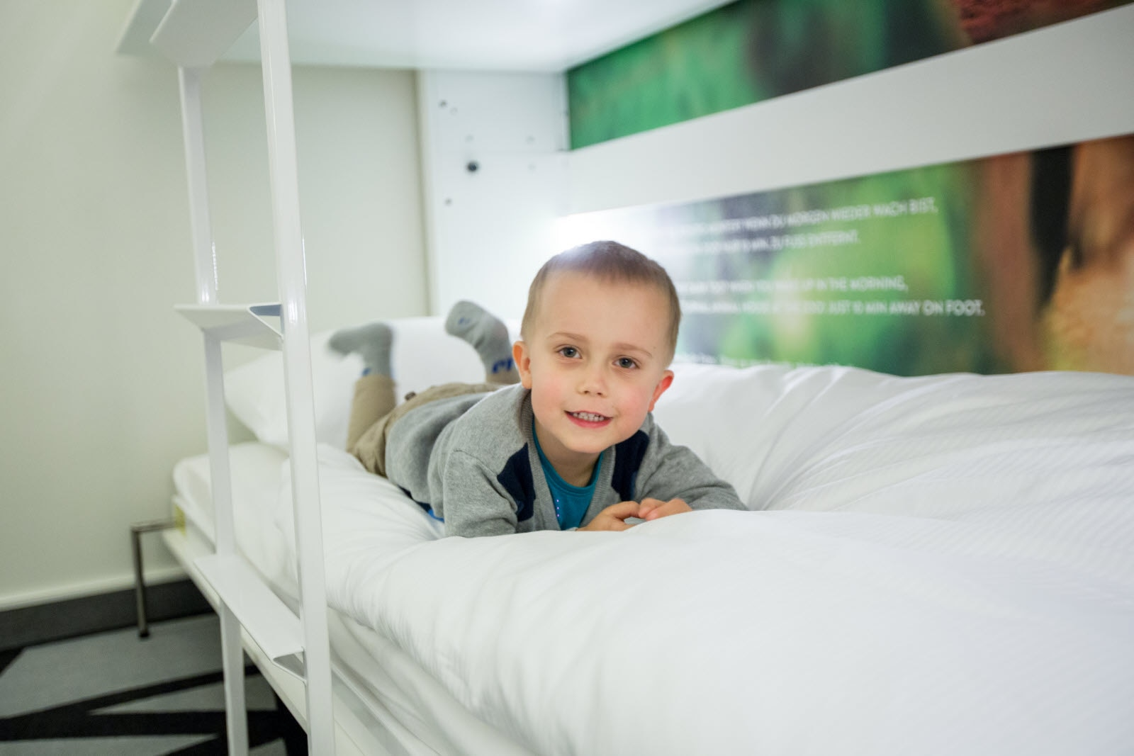 Boy on wall bed in room Family Plus