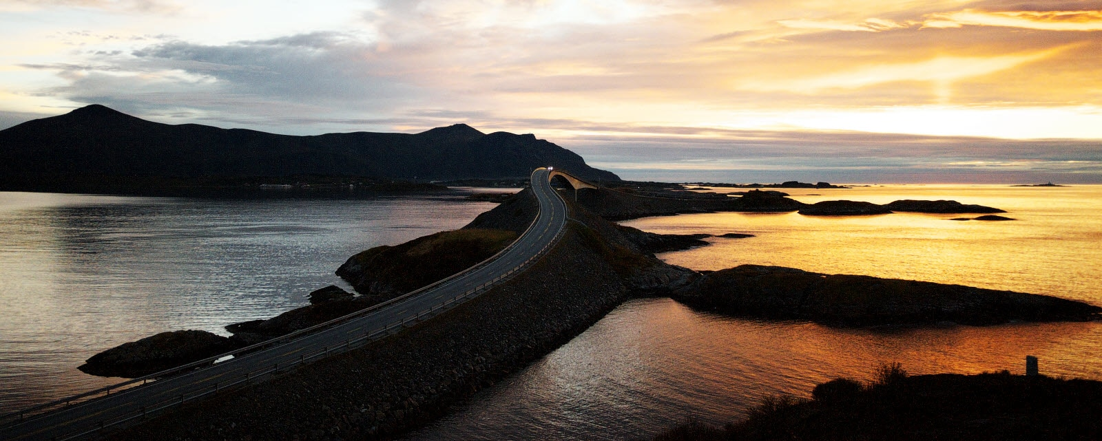 Norway and Molde in the sunset. The famouse Atlantic highway with its winding road and bridges.